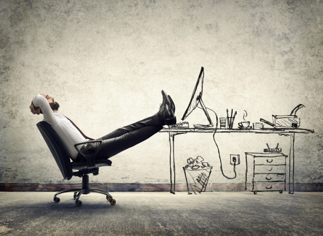 relax in office - man sitting on the drawing of desk